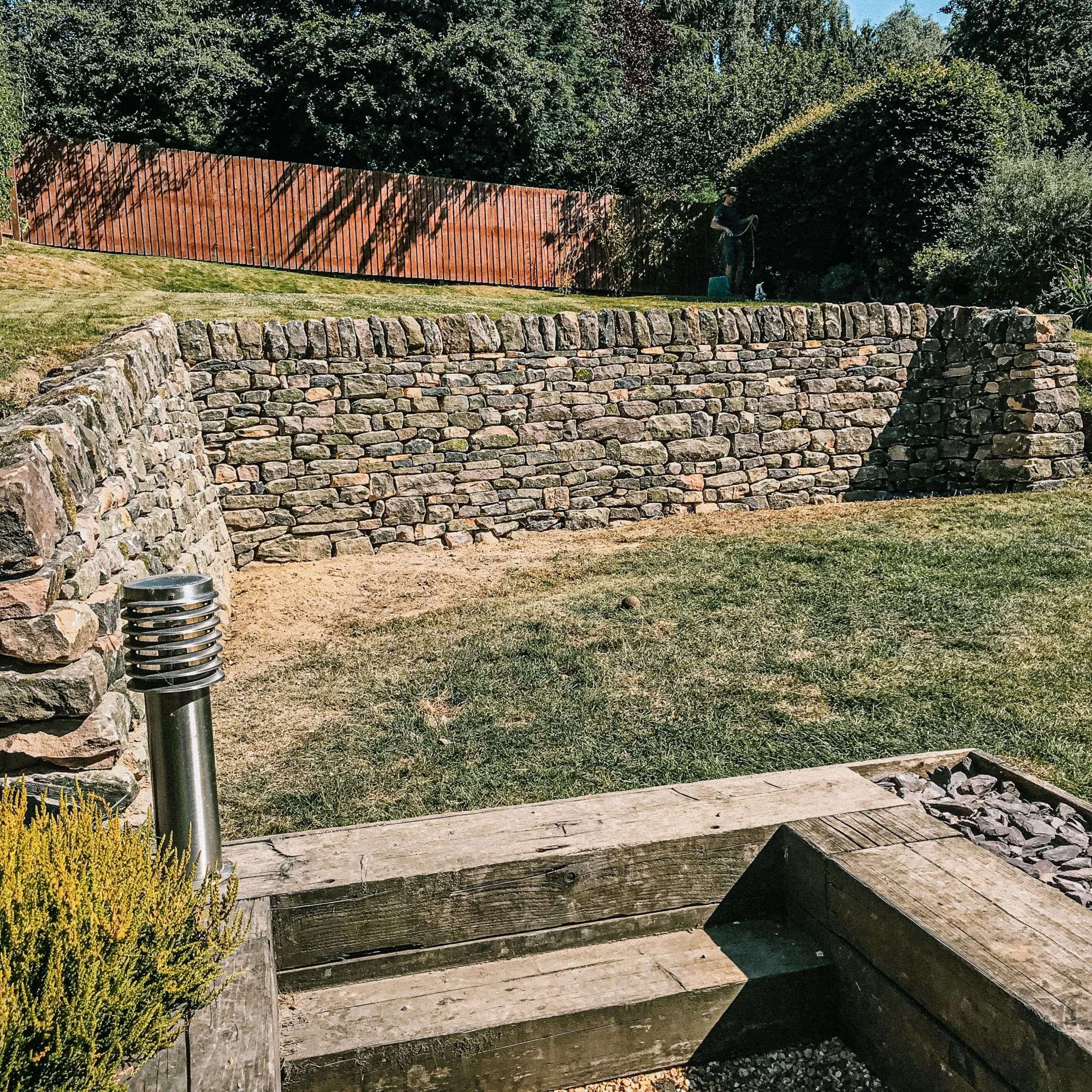 A  photo of a retaining dry stone wall with two corners built by Silver Oak in Fulwood, Sheffield