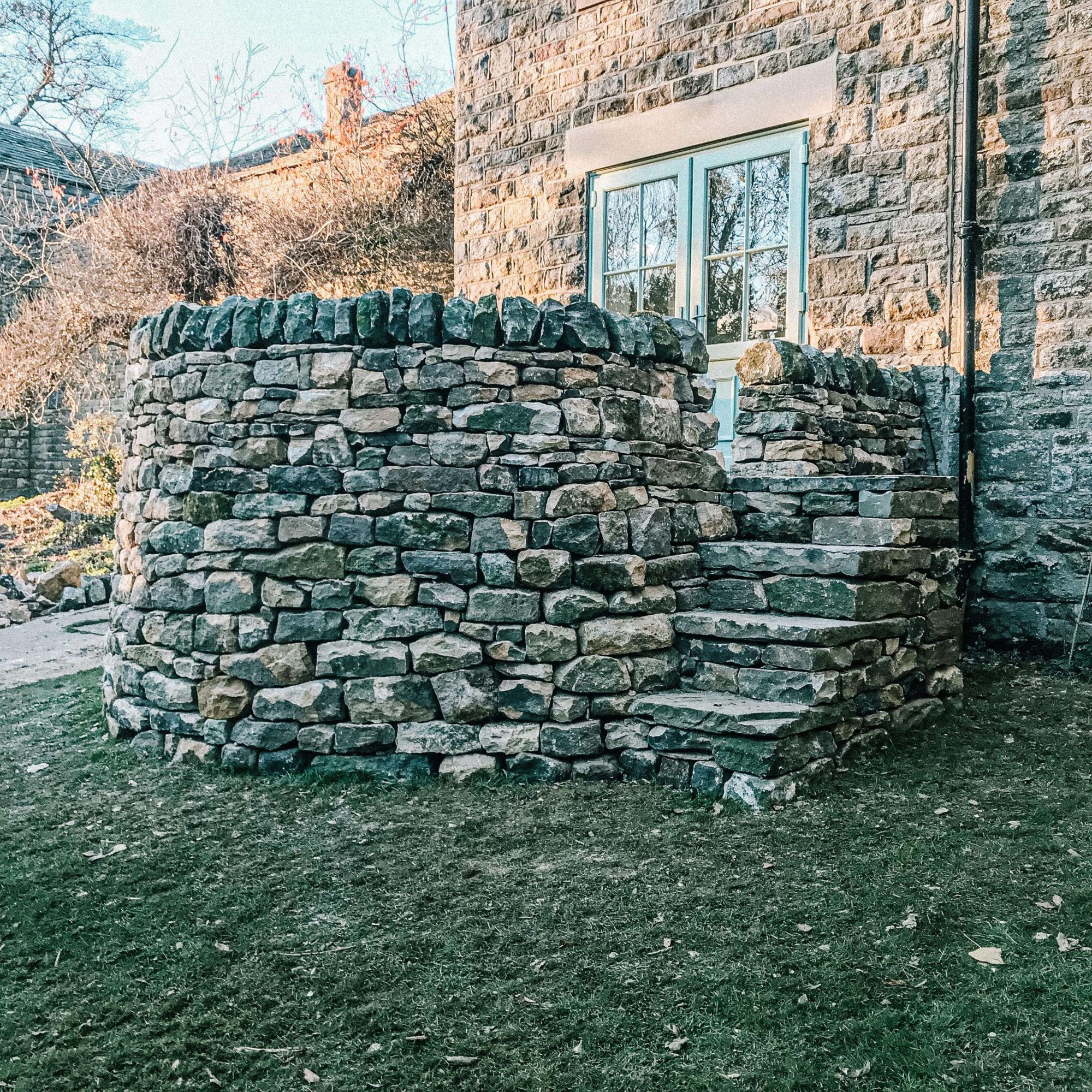 A circular dry stone wall with steps in Chesterfield
