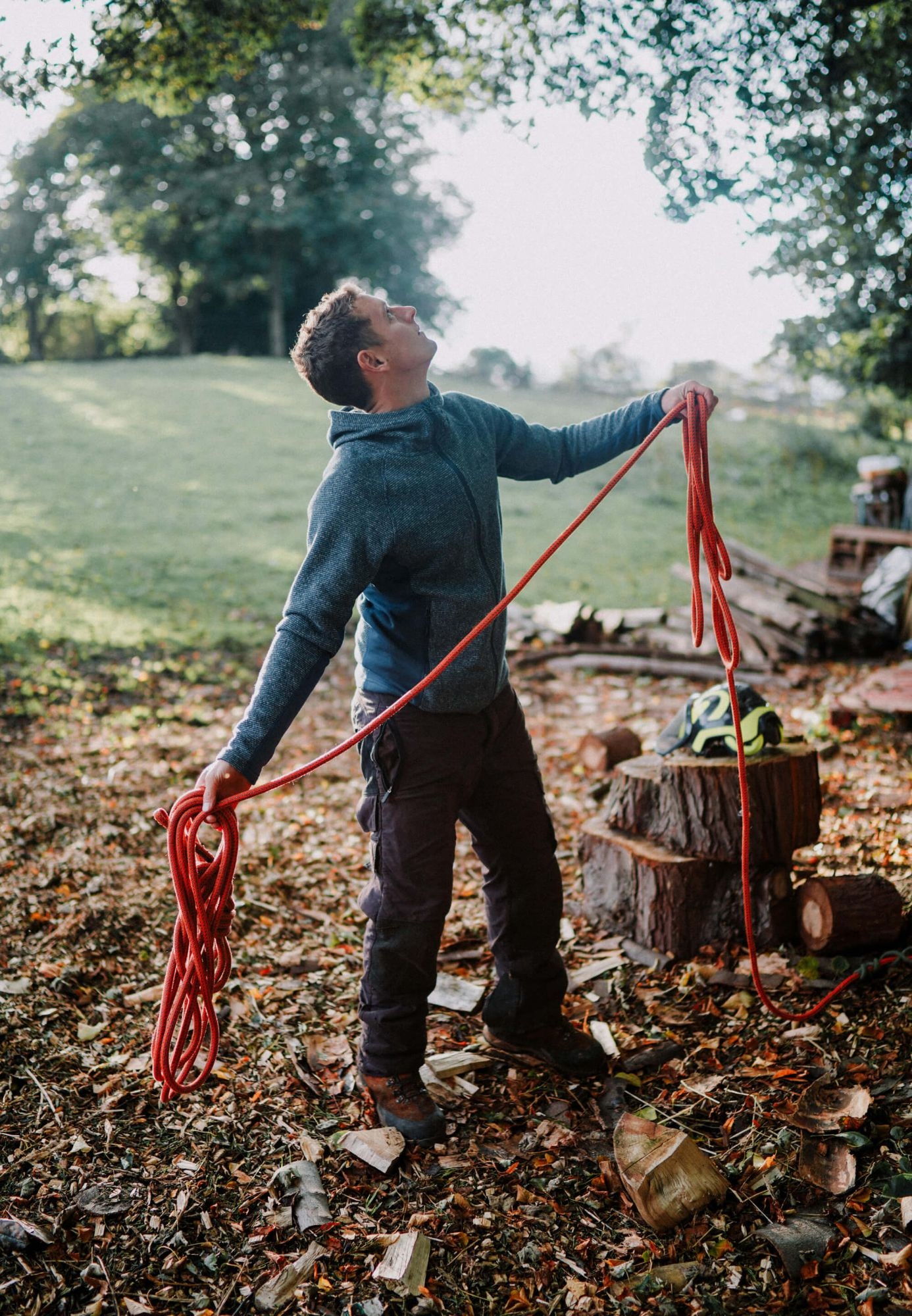 A photo of a Tree Surgeon from the Silver Oak team throwing a rope into the tree to start climbing